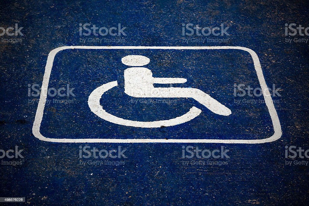 Cracked Texture of a Handicap Parking Space stock photo