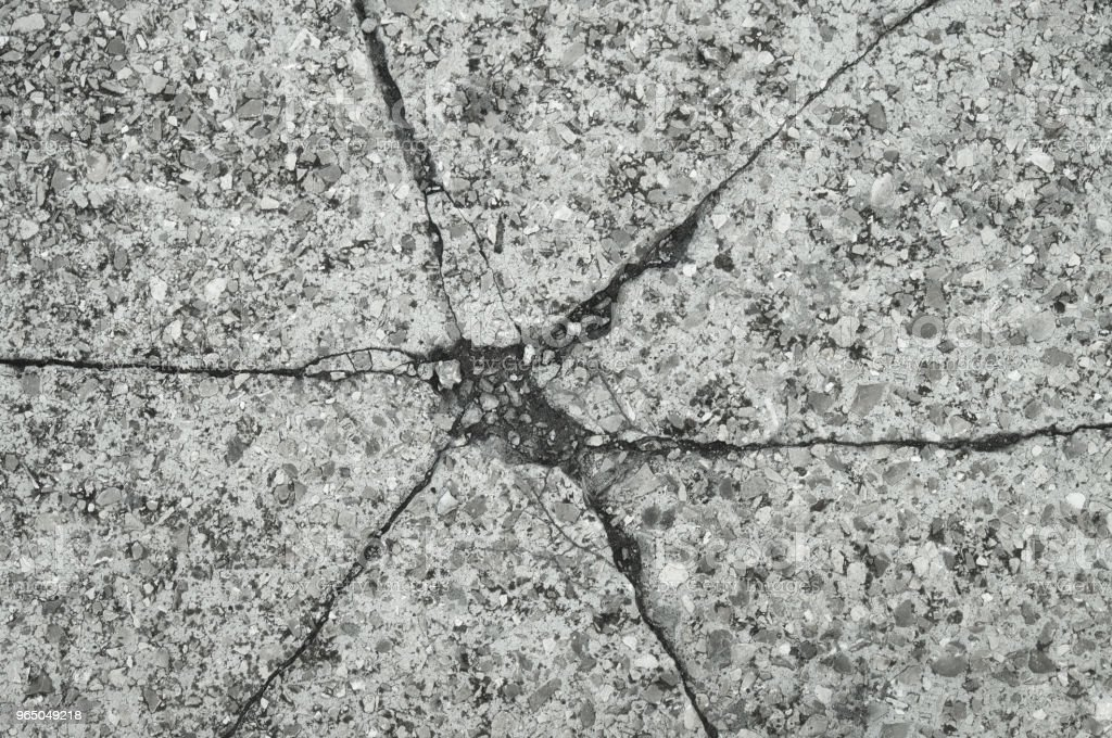 Cracked texture of small gravel stone in a concrete slab cement floor close up royalty-free stock photo