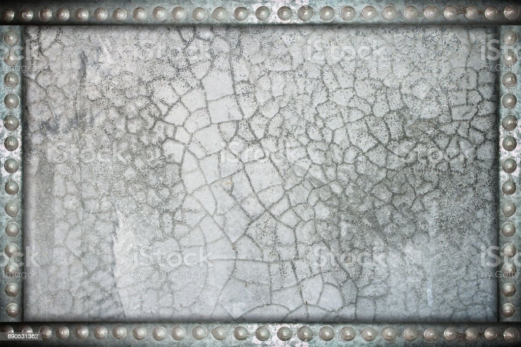cracked wall background with metal rivets frame stock photo