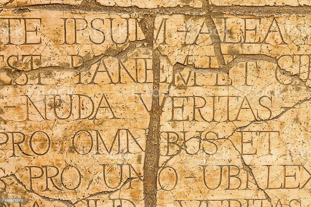 Cracked wall with Latin inscriptions. royalty-free stock photo