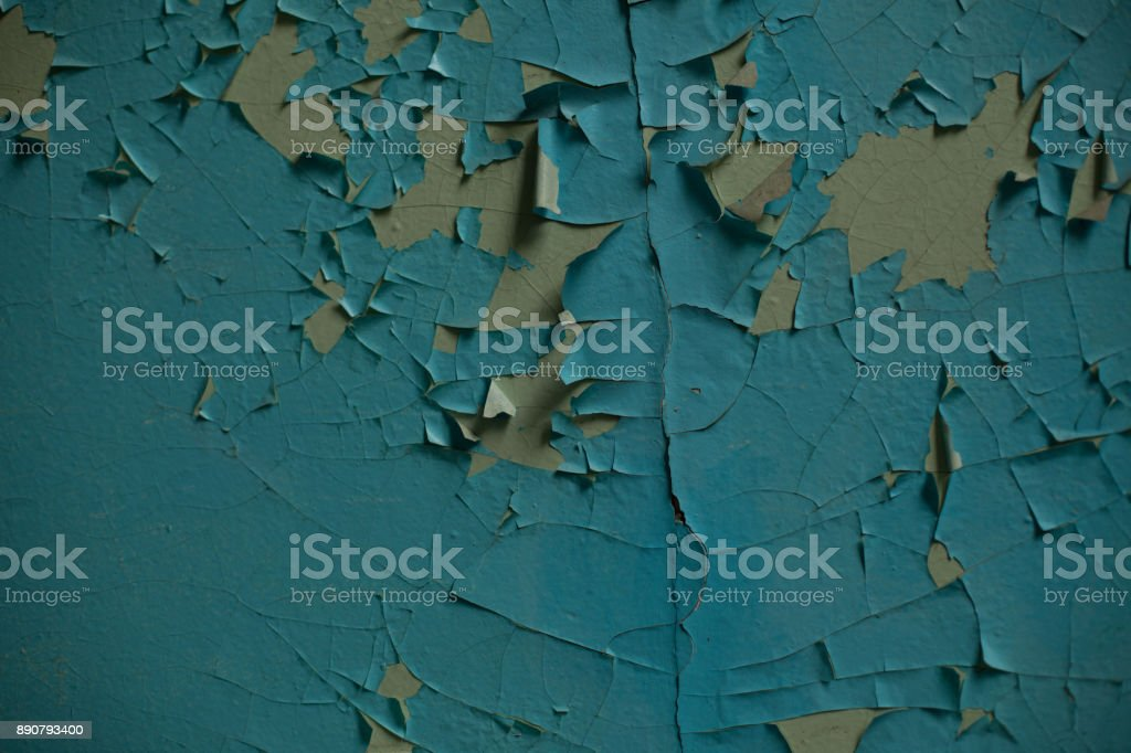 Cracked wall with old layers of paint in abandoned house stock photo