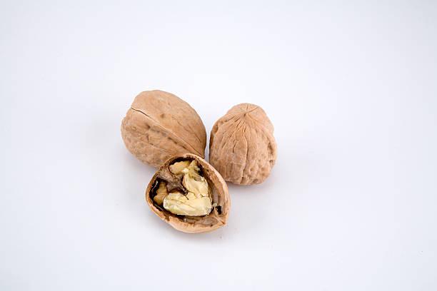 cracked walnuts 2 stock photo