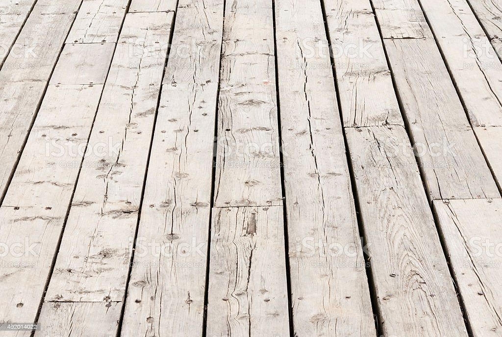 Cracked weathered wood deck boards stock photo