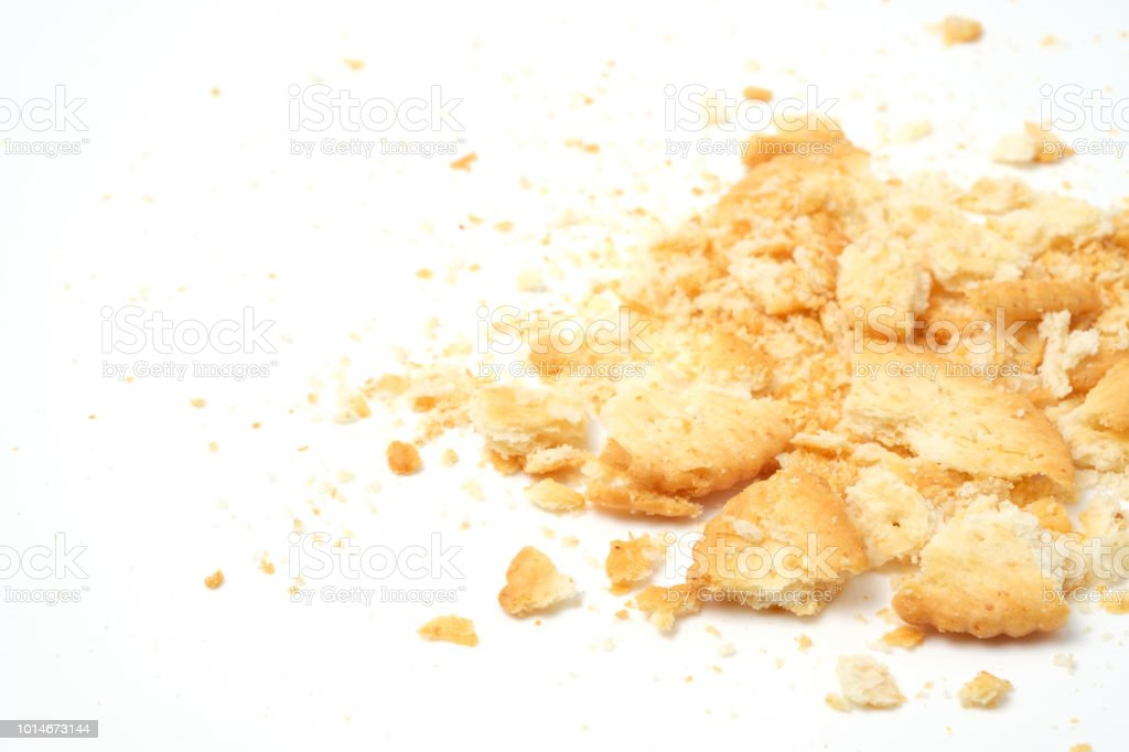 cracker crumbs isolated over white background with copy space stock photo