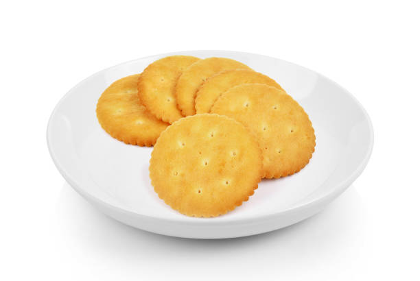 Cracker in plate on white background stock photo