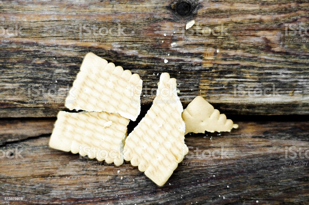 Cracker on the old board stock photo