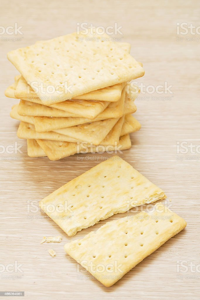 Cracker on wooden background stock photo