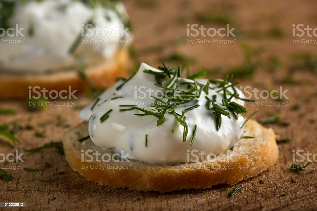 Cracker with cream cheese stock photo