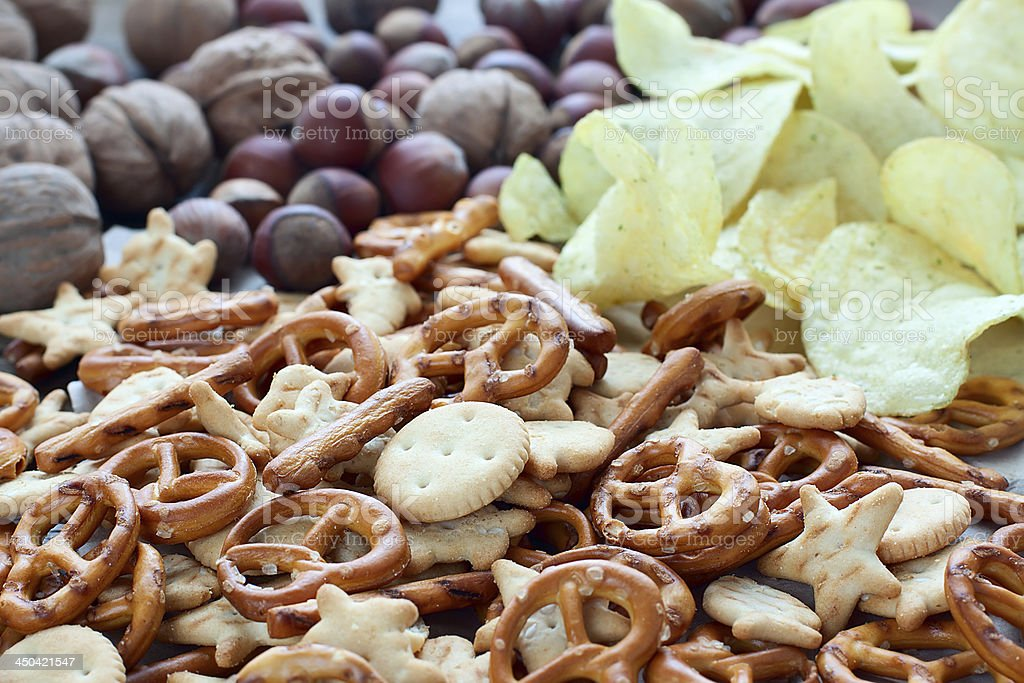 crackers, nuts and potato chips stock photo