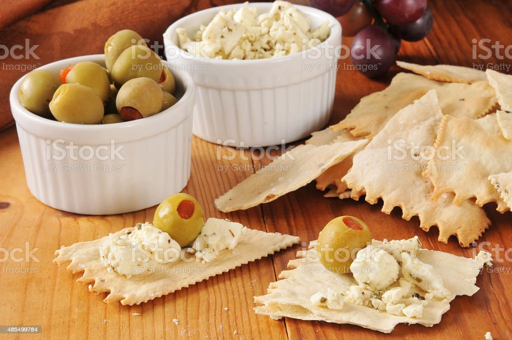 Crackers, olives and feta cheese stock photo