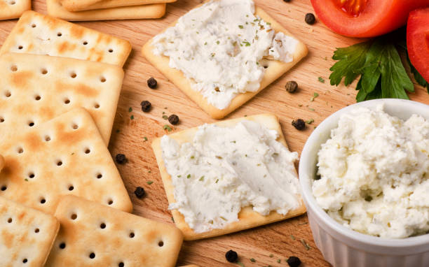 Crackers with cream cheese stock photo
