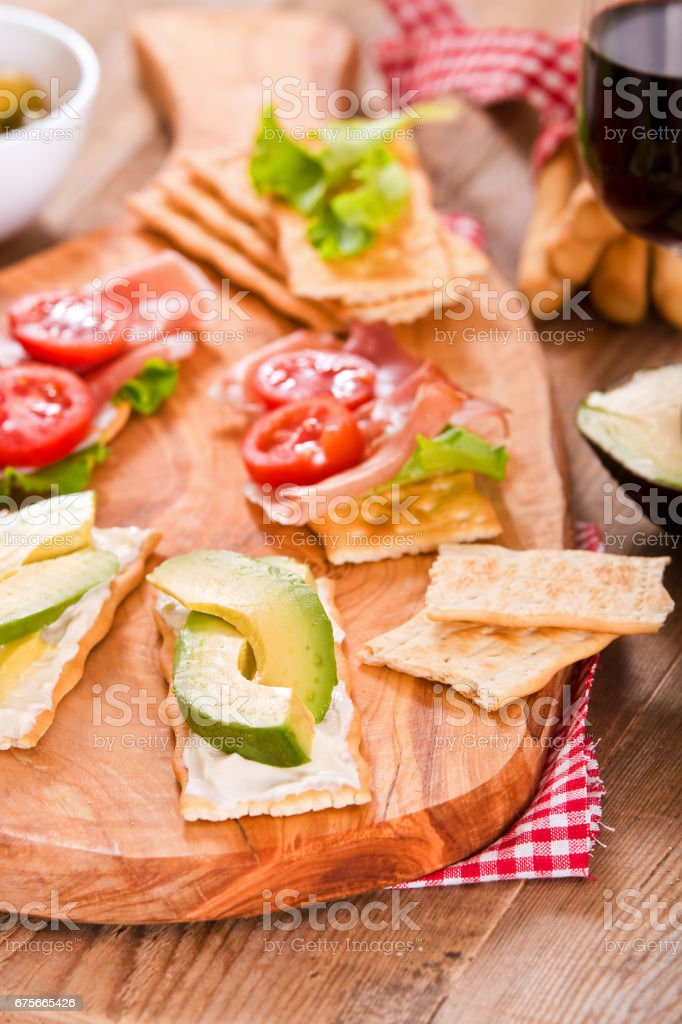 Crackers with ham and avocado. royalty-free stock photo