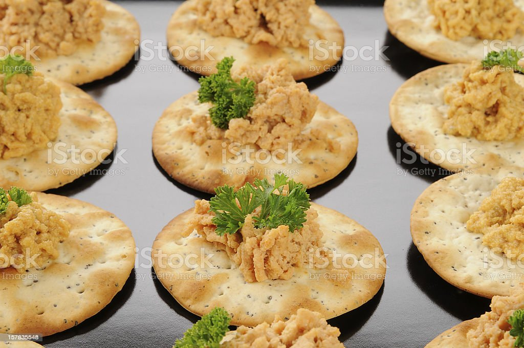 Crackers with lobster dill spread stock photo