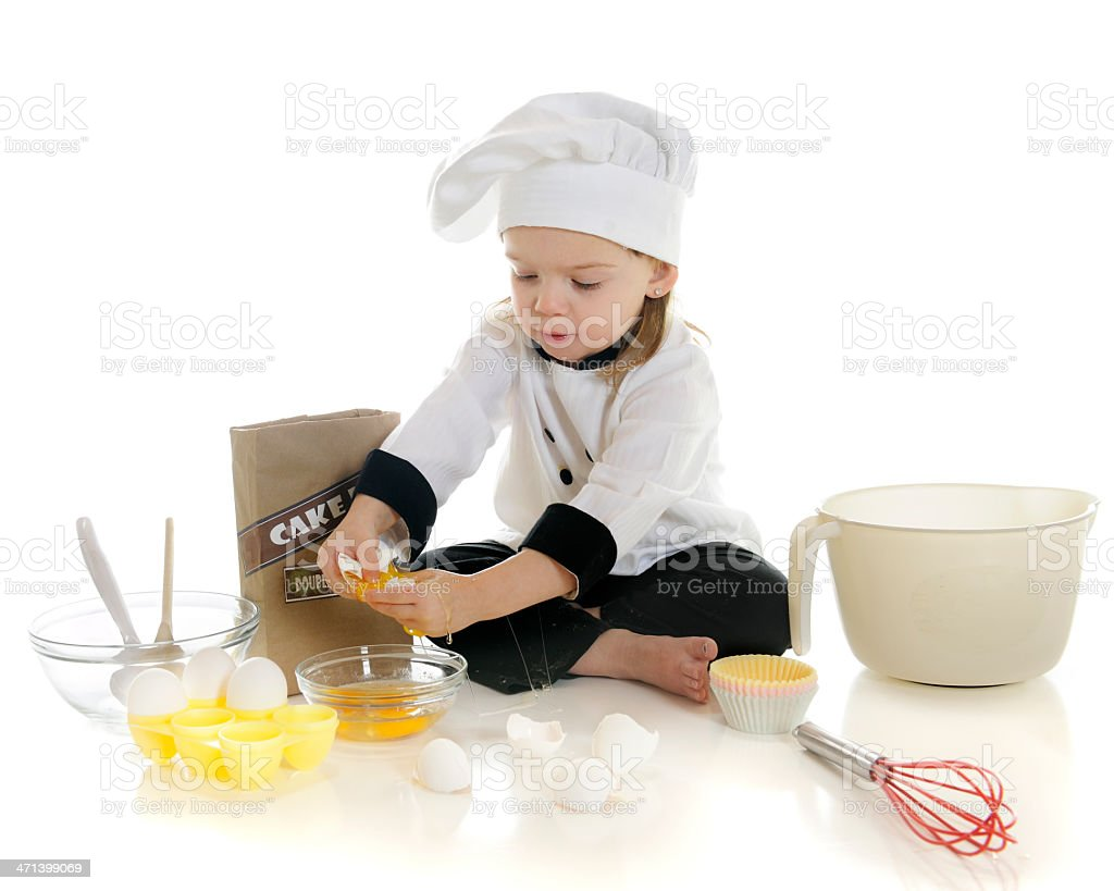 Cracking Eggs stock photo