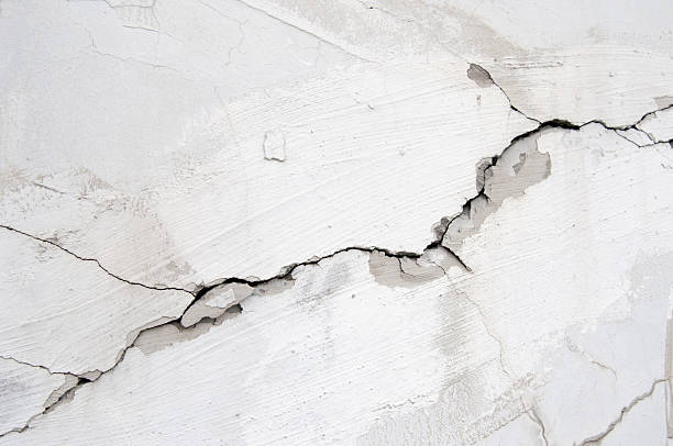 Cracking Wall Cracking Wall close-up. ruined stock pictures, royalty-free photos & images