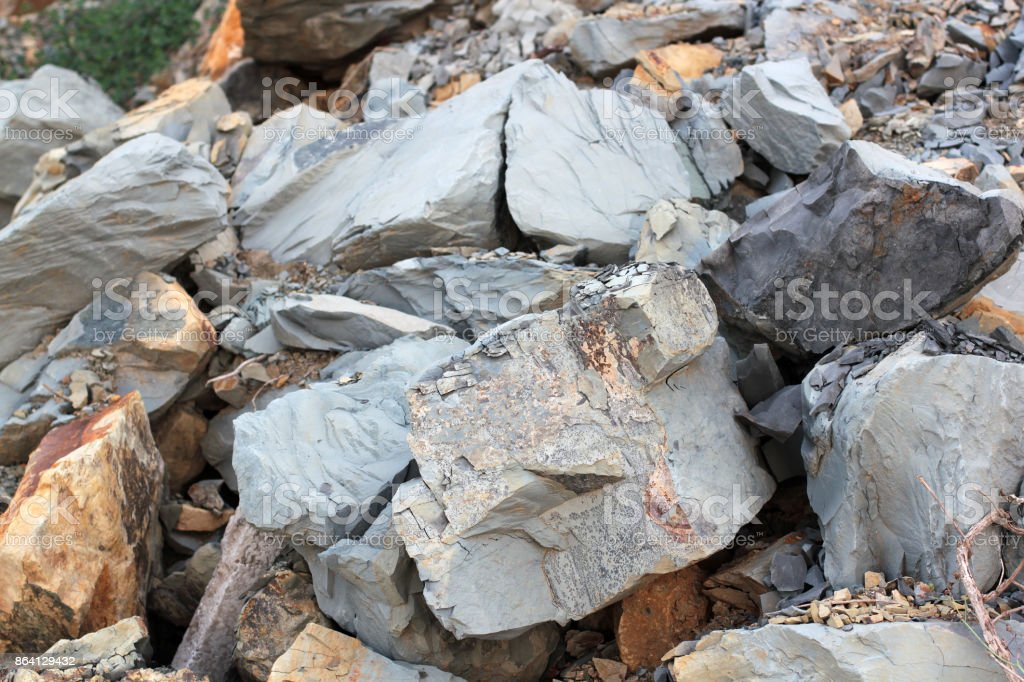 Cracks and colorful layers of sandstone background. A big heap of sandstones, storage space of various natural sandstone. The pattern of the variegated sandstones. Layers of toning colored large stones royalty-free stock photo