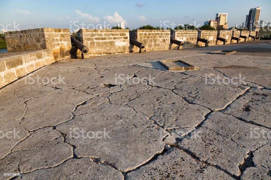 Cracks in the ground and Cannons stock photo