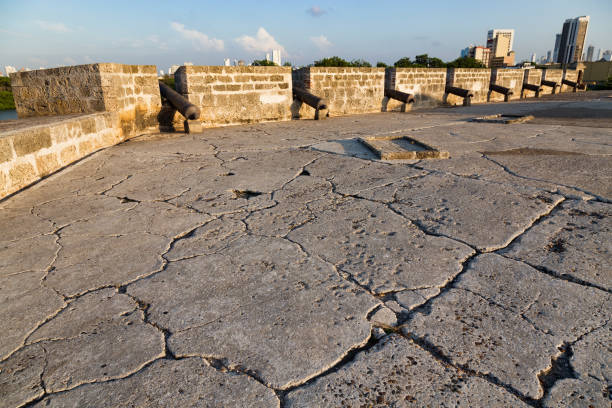 cracks in the ground and cannons - cartagena museum stock photos and pictures