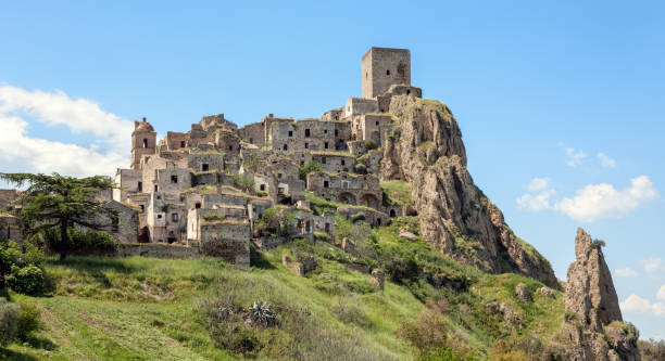 Craco, uninhabited village in Basilicata - Province of Matera, Italy Hilltop ghost town called Craco. matera italy stock pictures, royalty-free photos & images