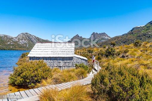 Tasmania, Australia - December 9, 2019: Tourists are enjoying the view of Cradle Mountain and Dove Lake in Tasmania, Australia.