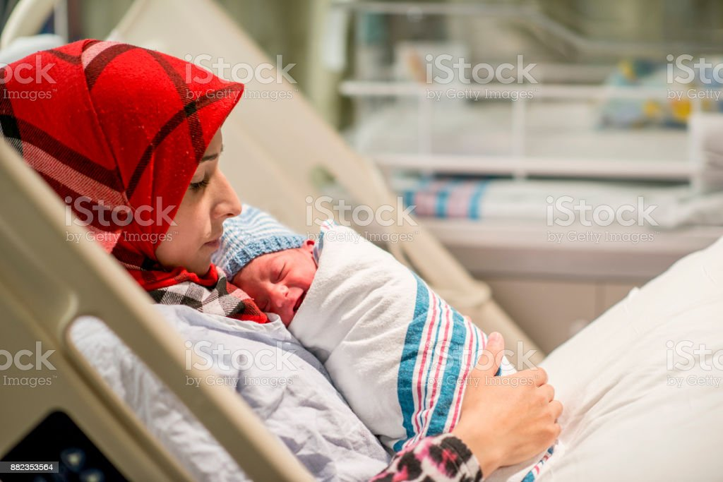 Cradling The Baby stock photo