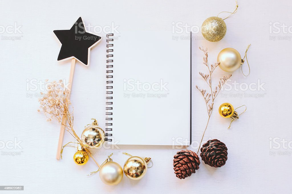 Craft and notebook mock up with christmas ornaments stock photo