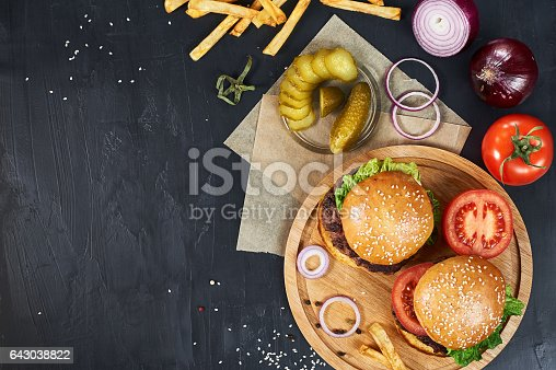1134487598 istock photo Craft beef burgers with vegetables and french fries. 643038822