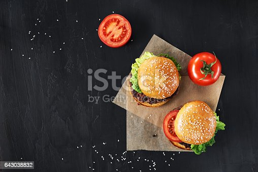 1134487598 istock photo Craft beef burgers with vegetables. 643038832