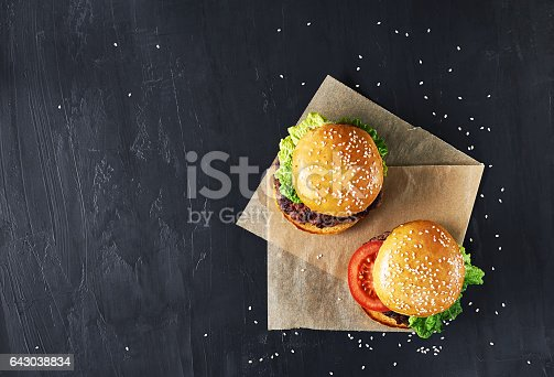 istock Craft beef burgers with vegetables. 643038834