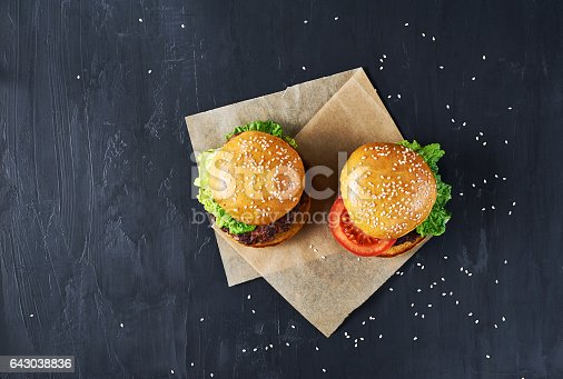 1134487598 istock photo Craft beef burgers with vegetables. 643038836