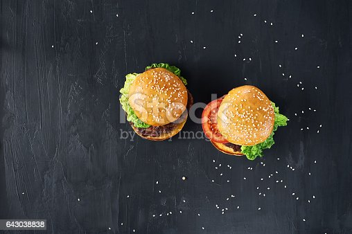 1134487598 istock photo Craft beef burgers with vegetables. 643038838