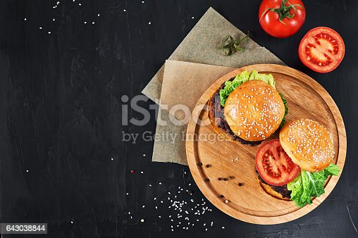 1134487598 istock photo Craft beef burgers with vegetables. 643038844
