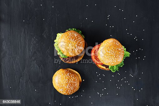 1134487598 istock photo Craft beef burgers with vegetables. 643038846