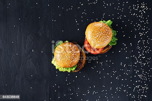 1134487598 istock photo Craft beef burgers with vegetables. 643038848