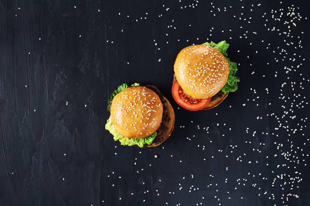 Craft beef burgers with vegetables. stock photo