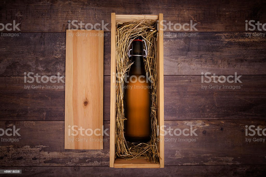Craft beer bottle in a wooden gift box stock photo