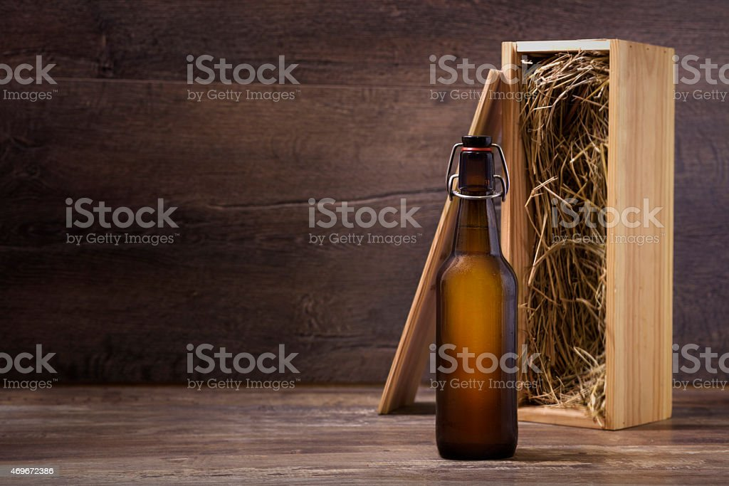 Craft beer bottle with a wooden gift box stock photo
