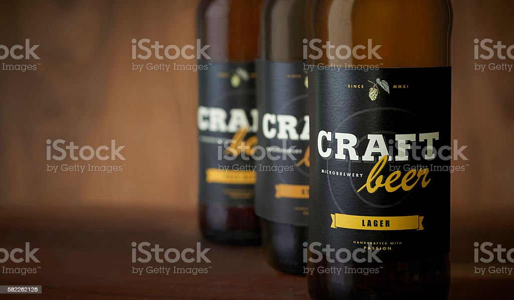 Craft beer bottles, black label – close up stock photo