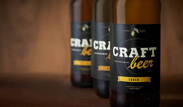 Craft beer bottles, black label – close up ストックフォト