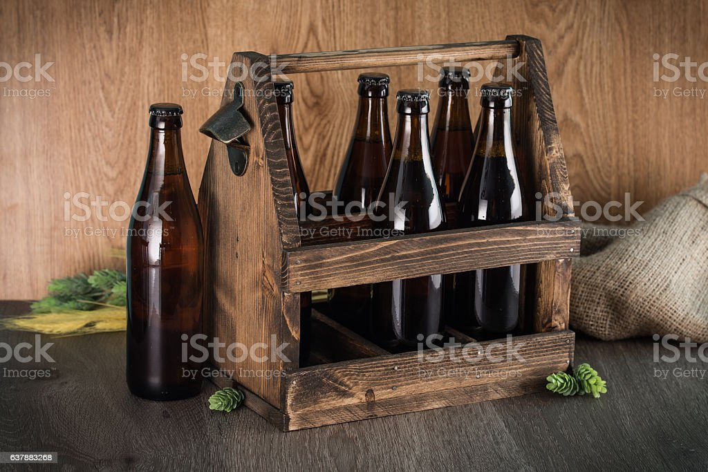 Craft beer from a wooden box. stock photo