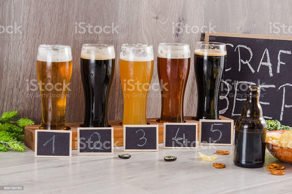 Craft Beer Tasting (Wood Background). stock photo