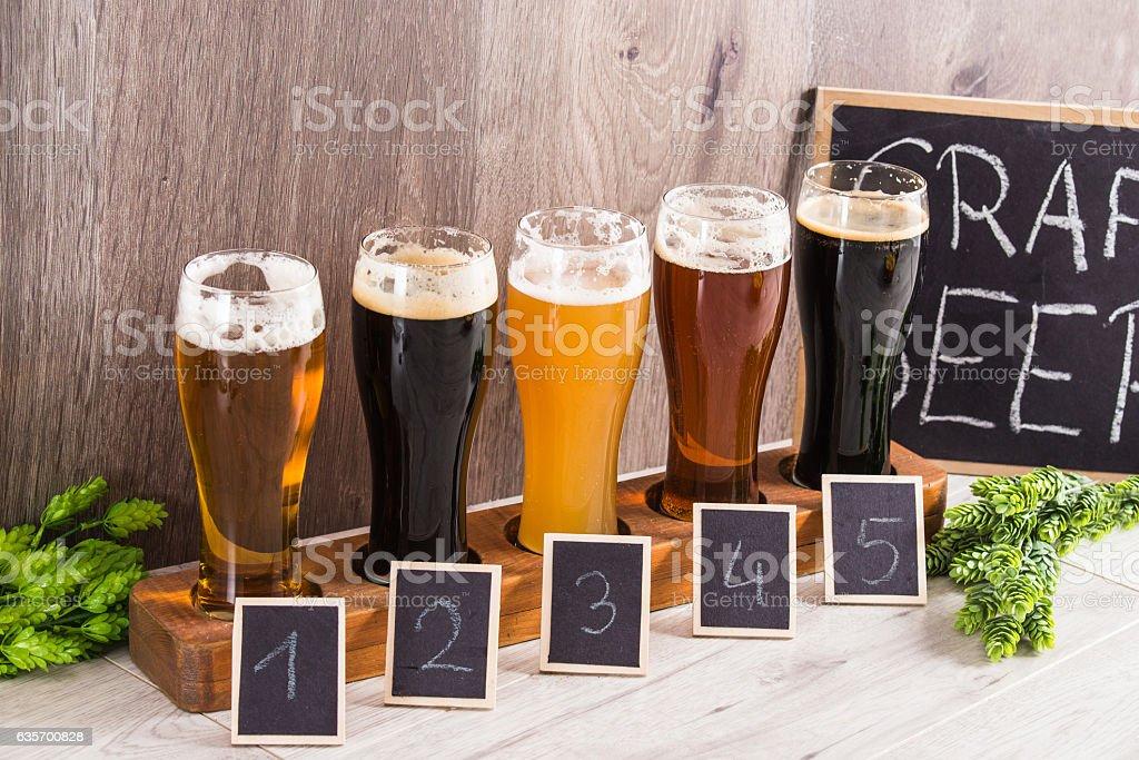 Craft Beer Tasting (Wood Background). stock photo