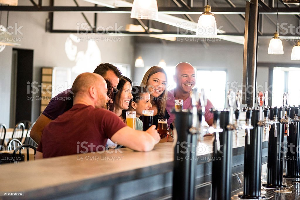 Craft Beer Tasting With My Friends At The Brewery stock photo