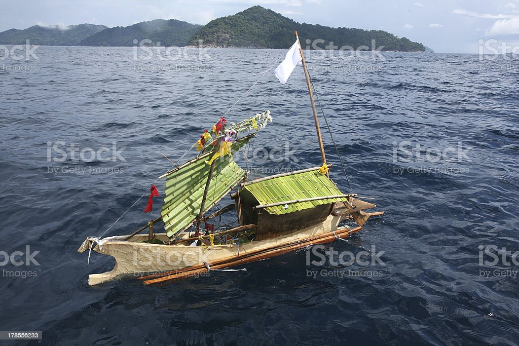 Craft boat floating in ceremony for respect to ancestor stock photo