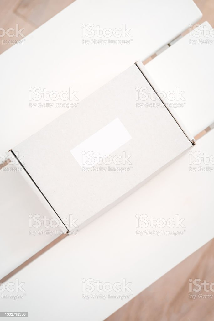 Craft boxes on white table from above stock photo