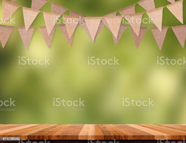 Craft brown flag banner hang over wood table with blur green tree picture id874238030?b=1&k=6&m=874238030&s=612x612&h=hnotmzliaauvrlzx0q8tp8zusi64tkfi1sc5gs2deh0=