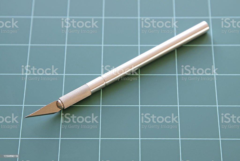craft knife on cutting mat stock photo