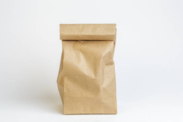 Craft paper bag on white background, not isolated stock photo