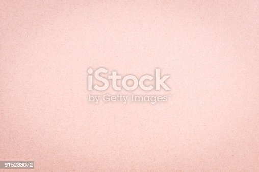Craft paper pink or rose gold textured background