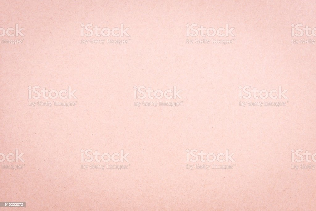 Craft paper pink or rose gold textured background stock photo